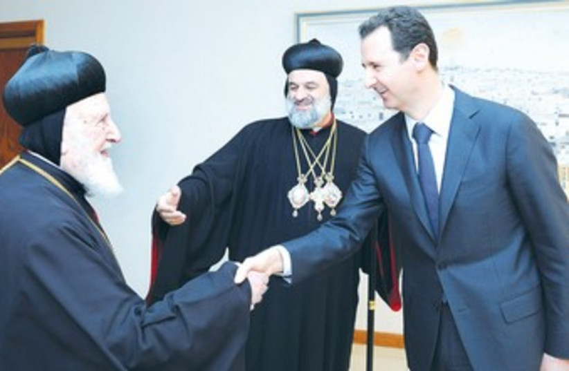 Assad meets with a delegation from the Syriac Orthodox Church (photo credit: REUTERS)