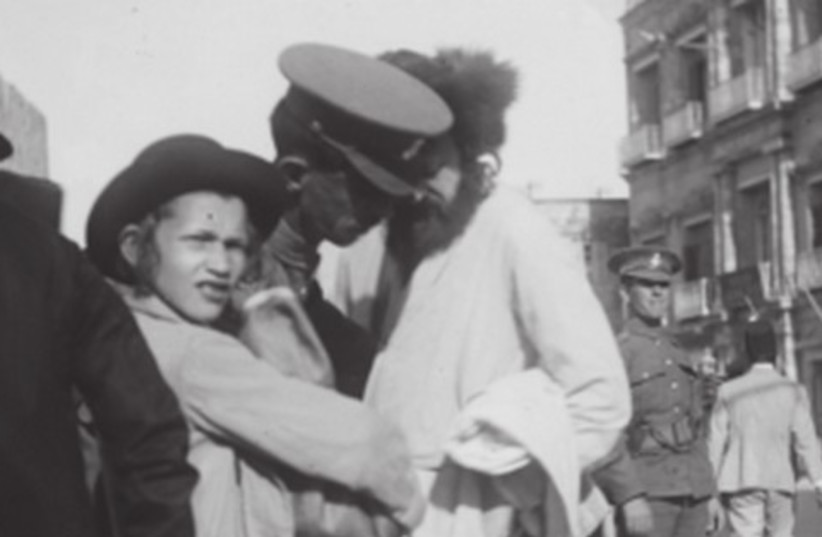 BRITISH POLICE officers corral Jewish men during the 1920 Jerusalem riots (photo credit: Wikimedia Commons)