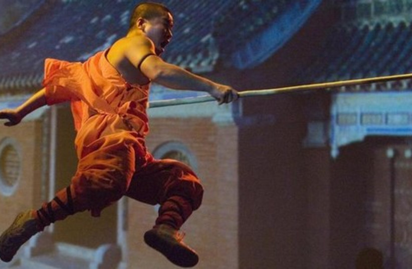 A Shaolin monk does kung fu [Illustrative] (photo credit: REUTERS)