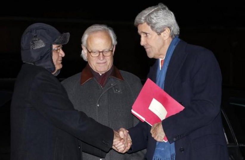 US Secretary of State Kerry (R), US envoy Martin Indyk (C) with PA chief negotiator Saeb Erekat (L), March 3, 2014. (photo credit: REUTERS)
