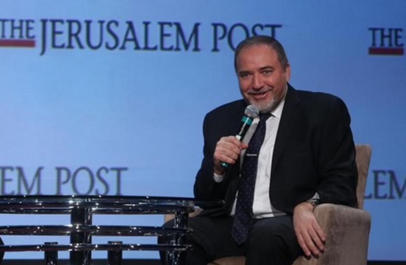 Foreign Minister Avigdor Liberman speaks at the 2014 Jerusalem Post Annual Conference, April 6, 2014. (photo credit: MARC ISRAEL SELLEM/THE JERUSALEM POST)