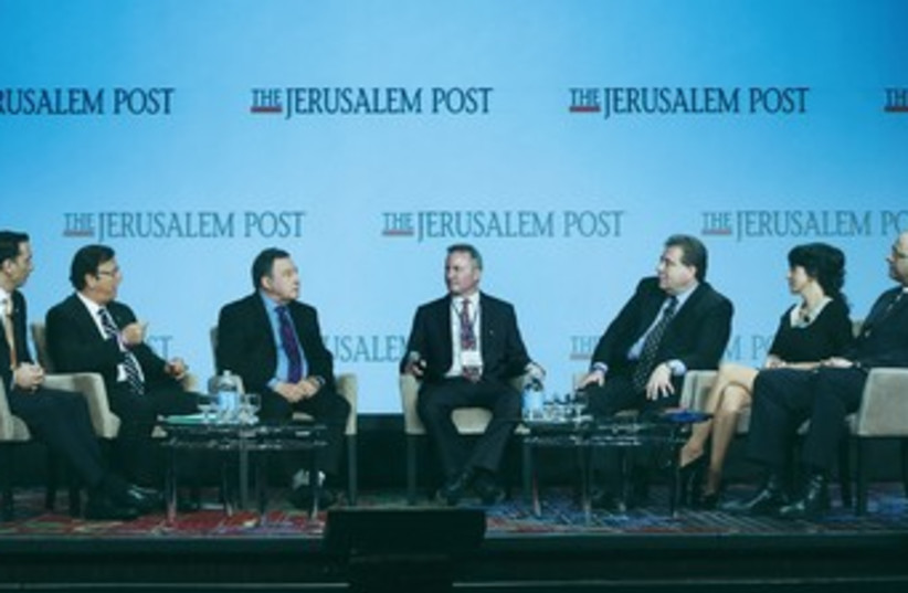 'JERUSALEM POST' editor-in-chief Steve Linde (center) leads the socioeconomic panel discussion at JPost Conference  (photo credit: MARC ISRAEL SELLEM/THE JERUSALEM POST)