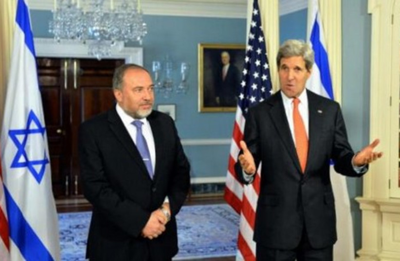 Foreign Minister Avigdor Liberman meets with US Secretary of State John Kerry in Washington, April 9, 2014. (photo credit: US STATE DEPARTMENT)