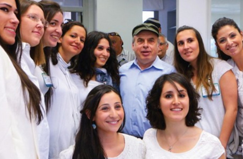 Jewish Agency chairman Natan Sharansky meets with French-language service representatives at the agency's Global Service Center. (photo credit: JAFI)