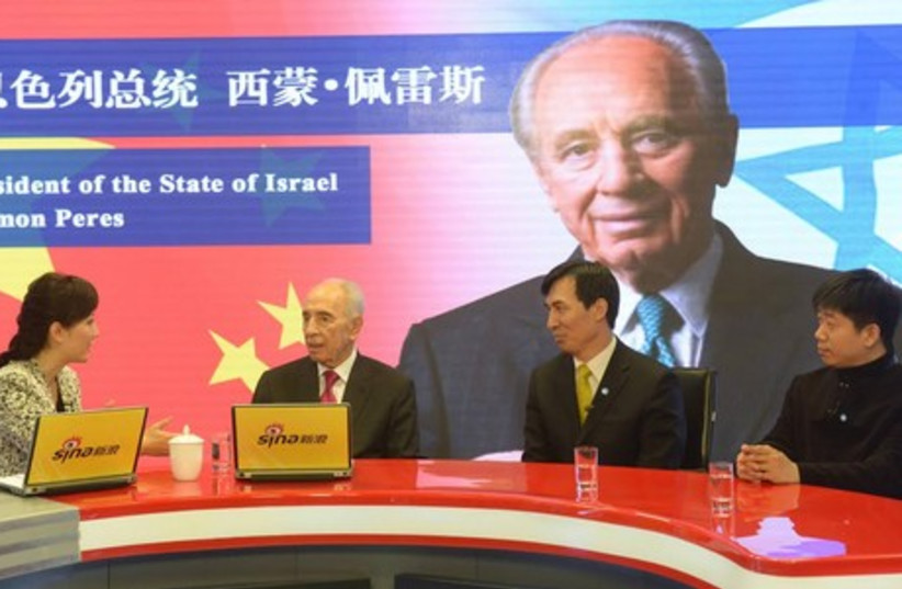 President Shimon Peres is a guest at Weibo, China's social media giant. (photo credit: GPO/AMOS BEN GERSHOM)