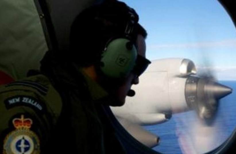 Searching for Malaysia plane (photo credit: REUTERS)