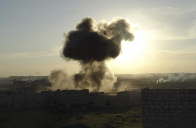 Smoke rises during clashes between government forces and rebels in Aleppo, April 11, 2014. (photo credit: REUTERS)
