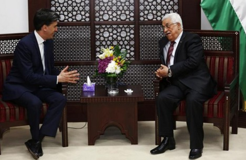 PA President Mahmoud Abbas (R) meets with Britain's Labour Party leader Ed Miliband in Ramallah April 12, 2014.  (photo credit: REUTERS)