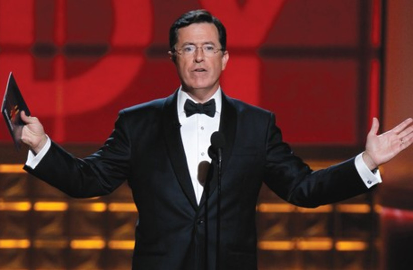 Comedy Central host Stephen Colbert who plays a conservative pundit will drop the character when he takes the reins from late-night legend David Letterman. (photo credit: REUTERS)