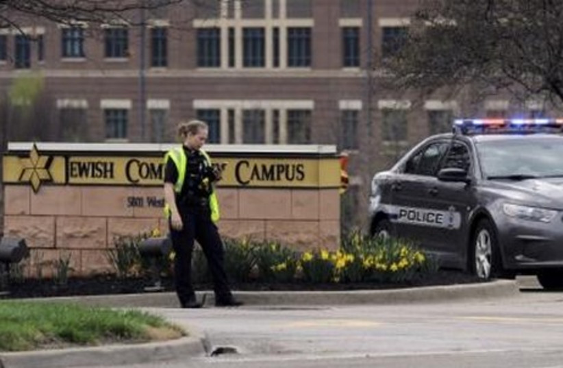 An Overland Park Kansas police officer at the scene of a shooting at the JCC of Greater Kansas City in Overland Park, Kansas April 13, 2014.  (photo credit: REUTERS)