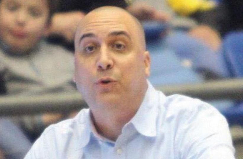 Maccabi Ashdod coach Eric Alfasi breathed a huge sigh of relief last night after his team avoided relegation to the National League, at least for a few more days (photo credit: ADI AVISHAI)