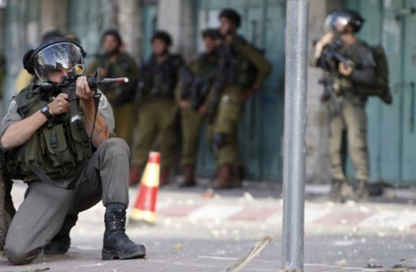 IDF after passover attack (photo credit: REUTERS)