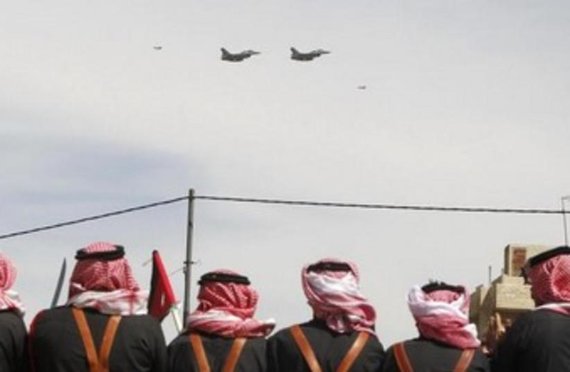 Jordanians watch an air force drill in Jordan. (photo credit: REUTERS)