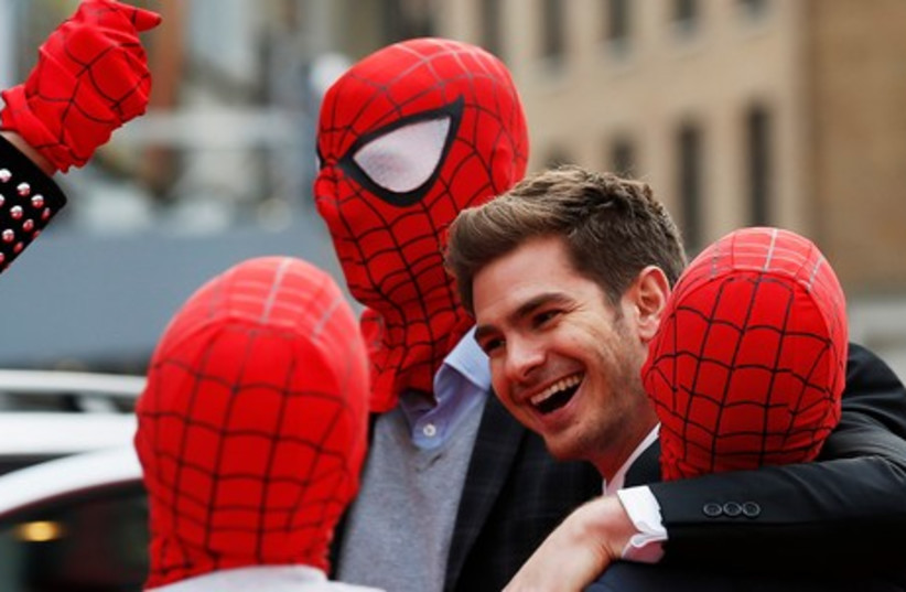 Andrew Garfield with Spidermen, April 10, 2014  (photo credit: REUTERS)