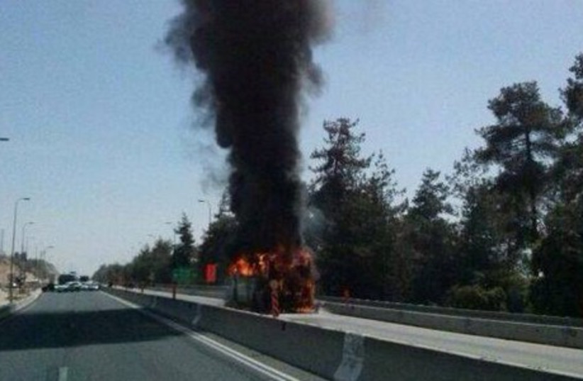 Burning bus on Highway 1, April, 16, 2014.  (photo credit: Courtesy)