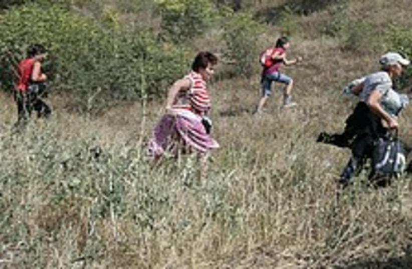 Georgians run 224.88 (photo credit: AP)