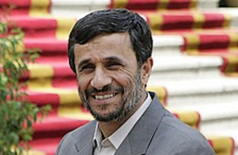 Ahmadinejad happy 224.88 (photo credit: AP)