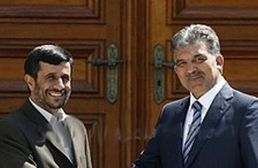 Ahmadinejad gul 224.88 (photo credit: AP)