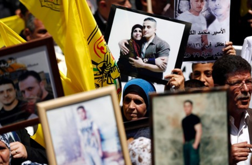 Palestinians mark Prisoner Day in Ramallah, April 17 (photo credit: REUTERS)