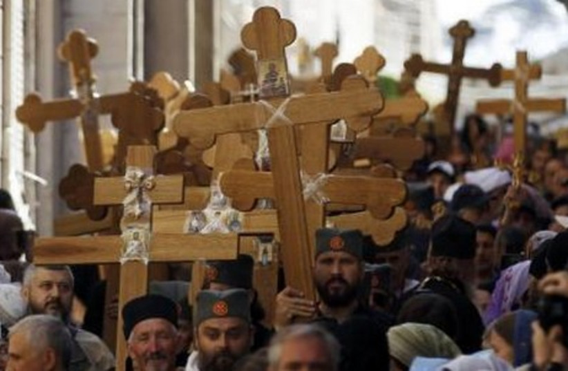 Christian worshippers in a procession marking Good Friday in Jerusalem's Old City April 18, 2014. (photo credit: REUTERS)