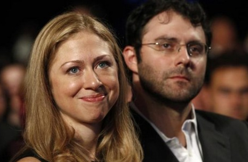 Chelsea Clinton and her husband, Marc Mezvinsky, attend a speech by US President Barack Obama at the Clinton Global Initiative in New York. (photo credit: REUTERS)