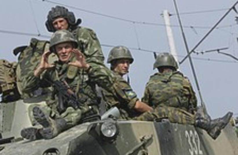 Russian troops happy 224.88 (photo credit: AP)
