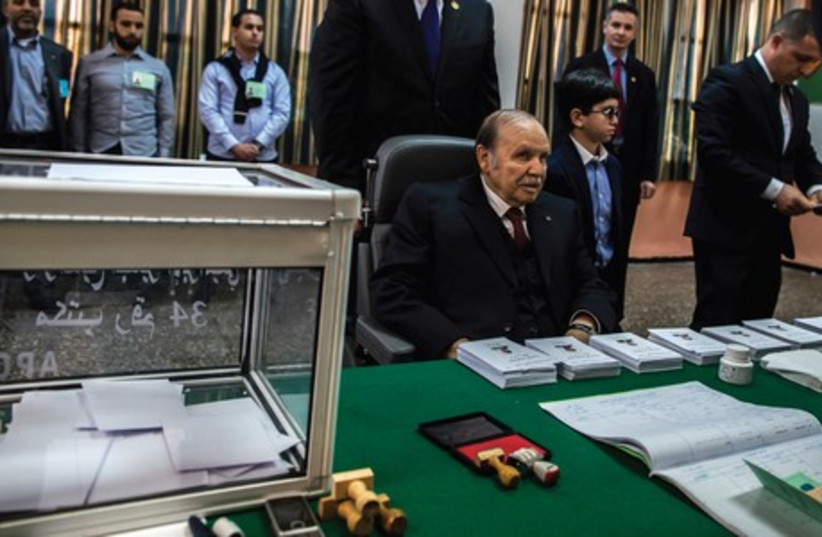 President Abdelaziz Bouteflika votes in Algiers on Thursday. (photo credit: ZOHRA BENSEMRA/REUTERS)