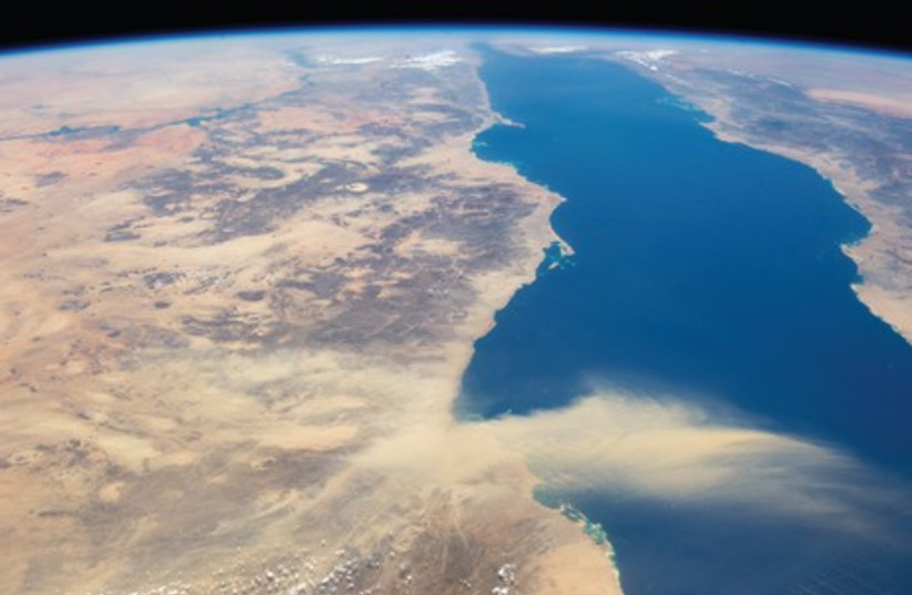 This astronaut's photograph provides a panoramic view of the Red Sea as a dust plume surges out from Egypt. (photo credit: REUTERS)