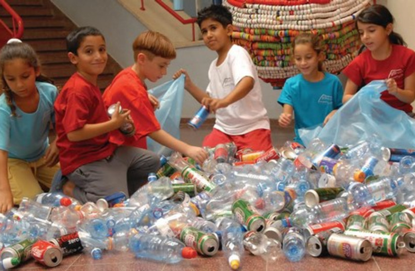 School children from Afek School in Rosh Ha'ayin sorting and recycling bottles. (photo credit: COURTESY AFEK SCHOOL ROSH HA'AYIN)