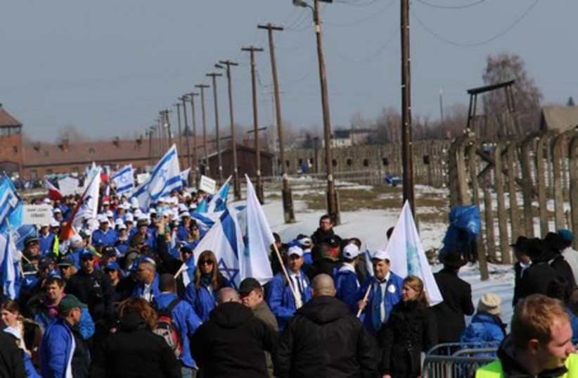 HUNDREDS OF high school students from across the globe march from Auschwitz to Birkenau last year in an annual event sponsored by International March of the Living. (photo credit: COURTESY OF BATIA DORI)