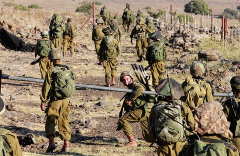 IDF soldiers participate in a drill on the Golan Heights. (photo credit: BAZ RATNER)
