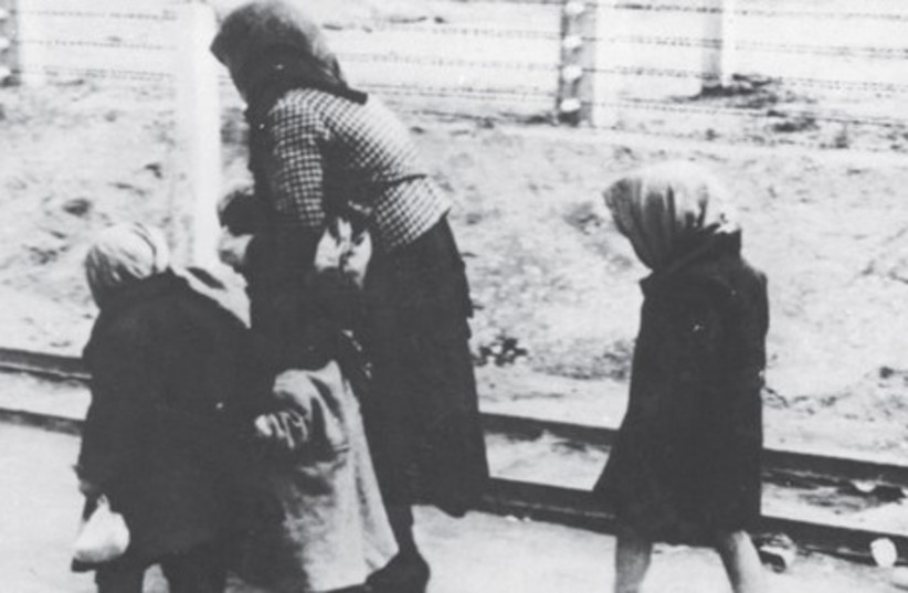 CHILDREN AND an old woman on the way to the death barracks of Auschwitz-Birkenau in Poland.  (photo credit: GERMAN FEDERAL ARCHIVES)