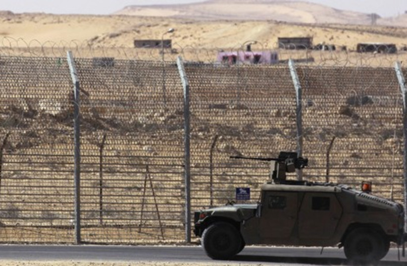 AN ARMORED IDF vehicle patrols a barrier along border with Egypt. (photo credit: REUTERS)