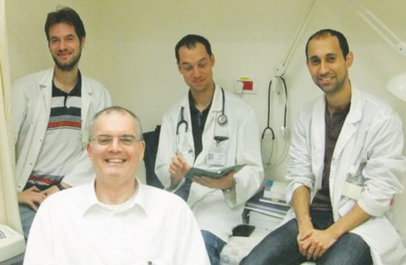 Dr. Yoav Lurie and young colleagues. (photo credit: JUDY SIEGEL-ITZKOVICH)