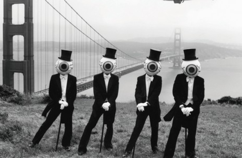 EYE SPY: The Residents are known for dressing up in tuxes, tails, top hats, canes and...giant eyeball heads. They have released over 60 albums, the most recent in 2013. (photo credit: Courtesy)
