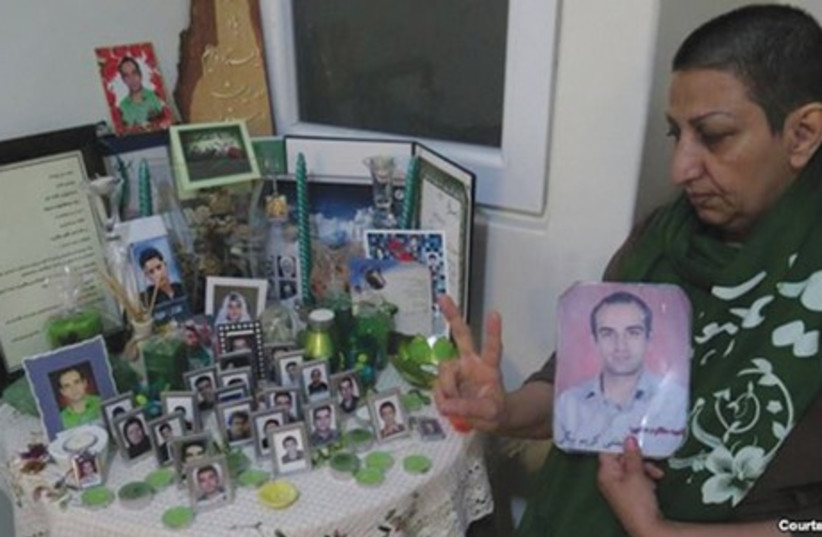 Shahnaz Karim Beigi, whose son was killed in the 2009 post-election in Iran, cut her hair in support of political detainees in Tehran's Evin Prison, whom she describes as her 'sons.' (photo credit: Courtesy)