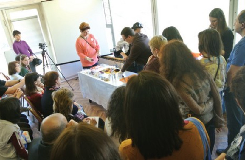 Participants watch a presentation on making gefilte fish by Chagall restaurant chefs at Limmud FSU. (photo credit: SETH J. FRANTZMAN)