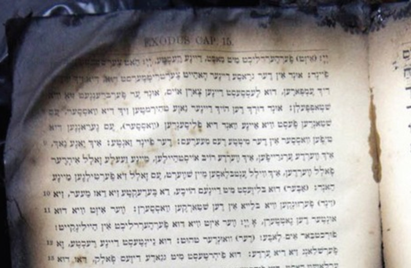 BURNT PRAYER books from a synagogue in Corfu, Greece that was firebombed in 2011 (photo credit: REUTERS)