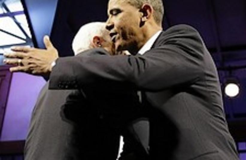 obama hugs mccain 224.88 ap (photo credit: AP)