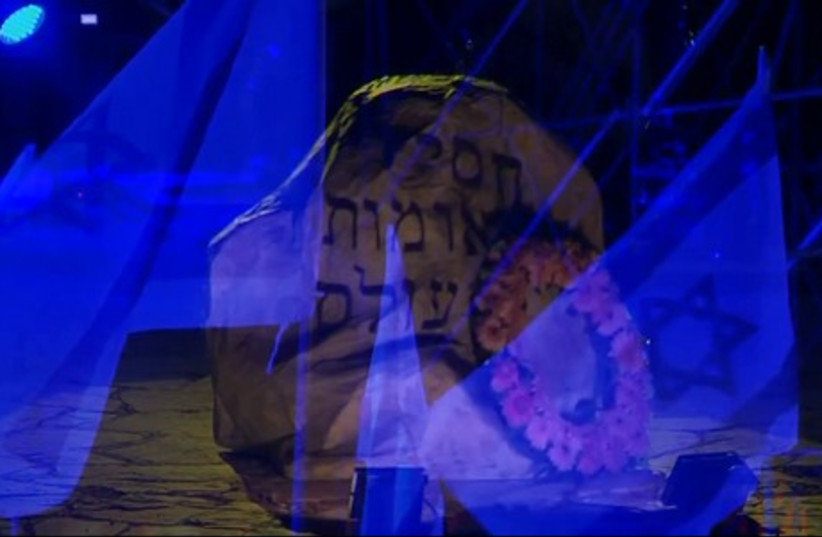 A memorial on the stage of the closing ceremonies of Holocaust Remembrance Day (photo credit: YOUTUBE SCREENSHOT)