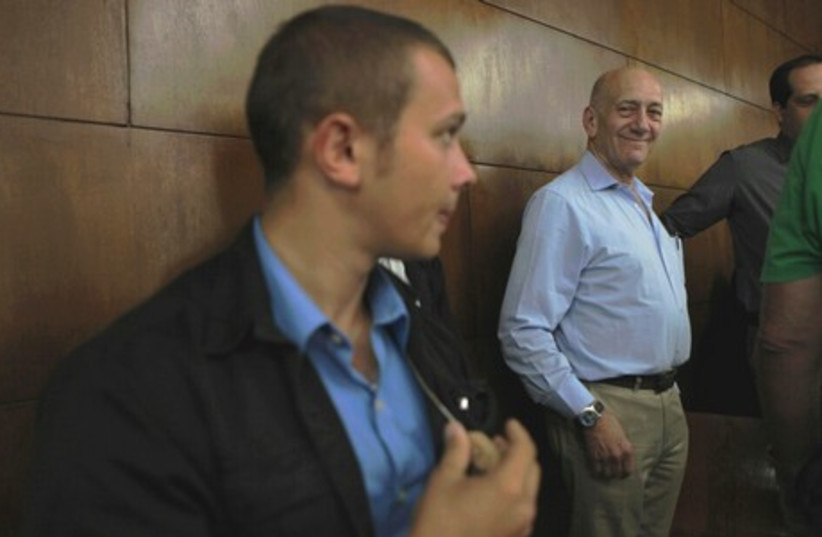 Former prime minister Ehud Olmert on the second day of sentencing hearings, April 29, 2014. (photo credit: DROR EYNAV/POOL)