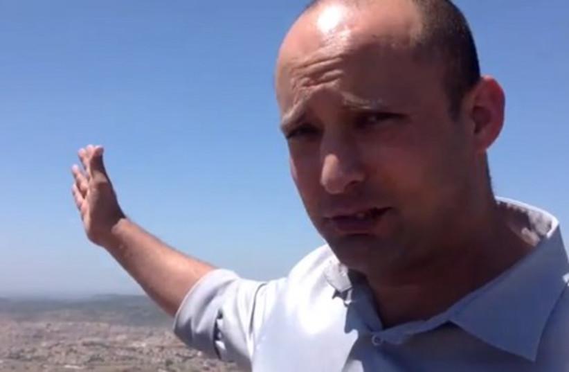 Economy Minister Naftali Bennett in the Gush Etzion settlement of Neveh Daniel (photo credit: YOUTUBE SCREENSHOT)