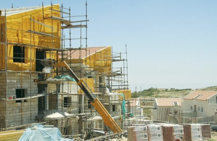 Construction in West Bank settlement of Efrat, April 29, 2014. (photo credit: TOVAH LAZAROFF)
