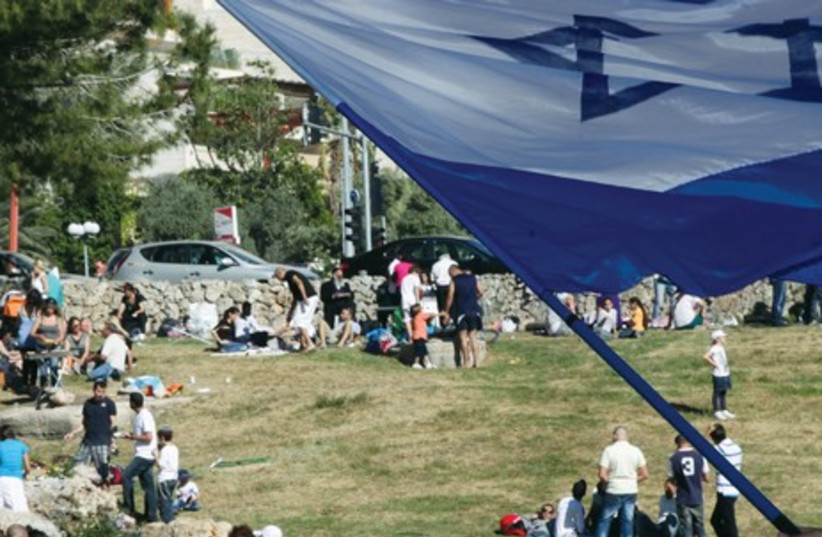 CELEBRATING INDEPENDENCE DAY at Sacher Park in Jerusalem. Our greatest triumphs have generally come on the heels of our greatest tragedies (photo credit: MARC ISRAEL SELLEM)