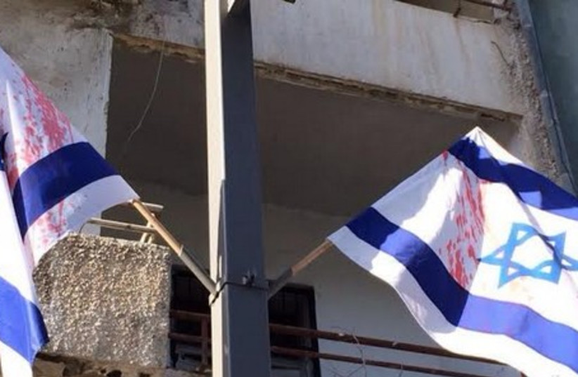 Israeli flags desecrated, May 1, 2014. (photo credit: ISRAEL POLICE)