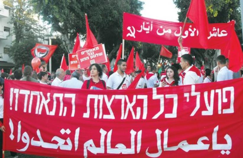 Marchers take part in May Day events in Tel Aviv. (photo credit: LIDAR GRAVÉ-LAZI)