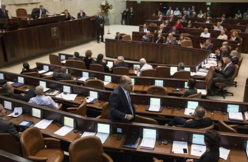 Lawmakers gather for a session in the Knesset. (photo credit: REUTERS)