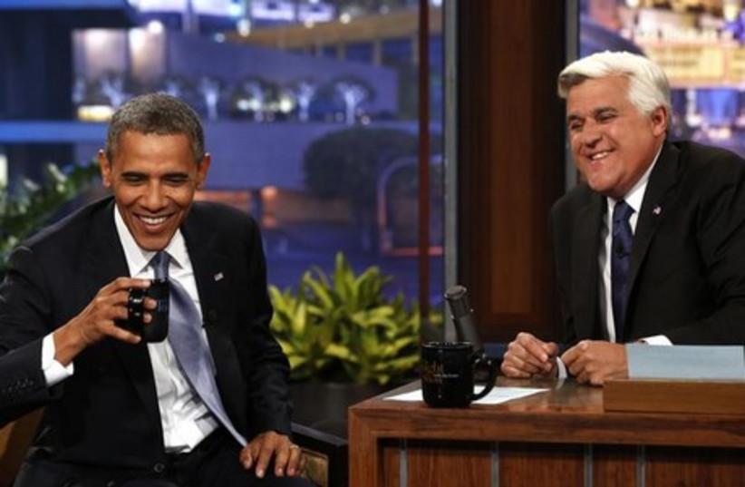 Former 'Tonight Show' host Jay Leno hosting President Obama. (photo credit: REUTERS)