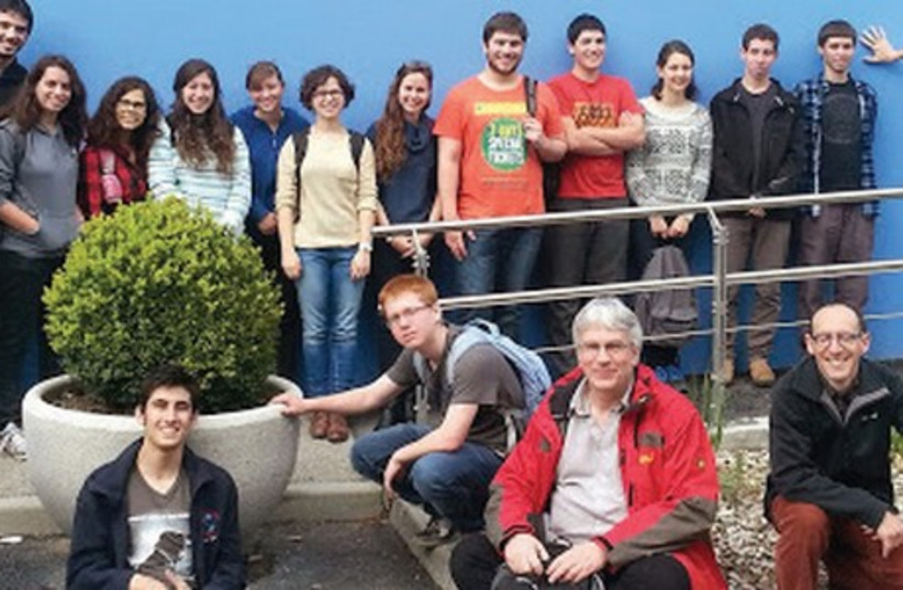 STUDENTS AND teachers from the Israel Arts and Sciences Academy pose for a group photo at the CERN Control Center in Geneva yesterday. (photo credit: COURTESY IASA)