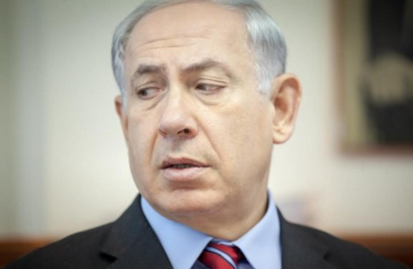 Prime Minister Binyamin Netanyahu speaks at the weekly cabinet meeting in Jerusalem. (photo credit: EMIL SALMAN/POOL)